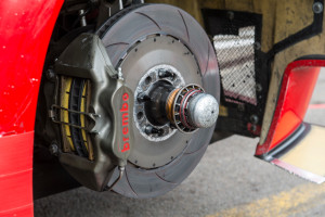Zolder, Belgium - April 21, 2013: Brembo disc brake on a AF Corse Ferrari 458 Italia GT3 race car in the pit lane before the race. The car is participating in the 2013 FIA GT championship.